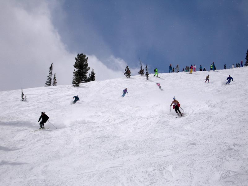 Skiers enjoy a run at Jackson Hole Mountain Resort, Wyoming
