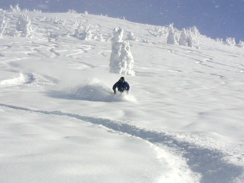 A snowboarder finds powder in the backcountry of Grand Targhee, Wyoming