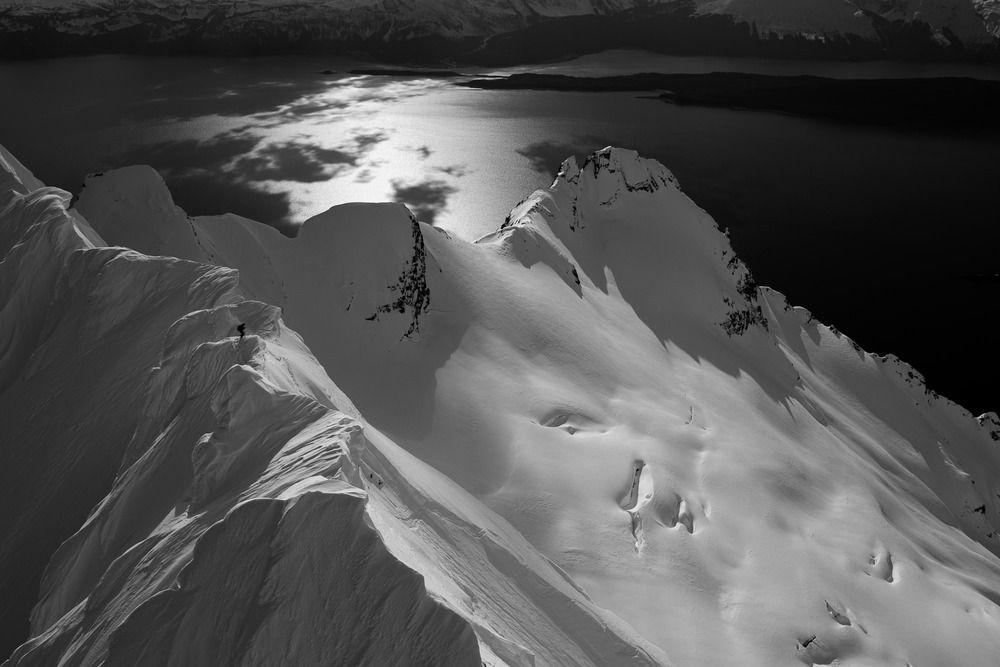 Reggie Crist standing on top of Keegan Peak with the Lynn Canal in the background. He is preparing for the second descent of this amazing slope. Photo by Will Wissman