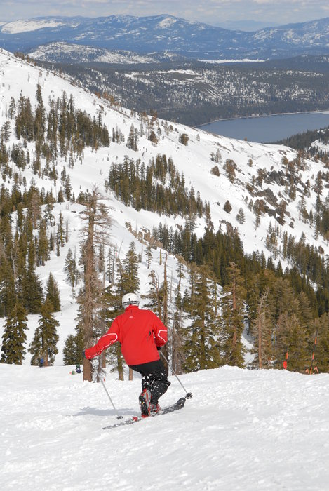 A skier gets a view of Donner Lake while going down a run at Sugar Bowl Ski Resort, California