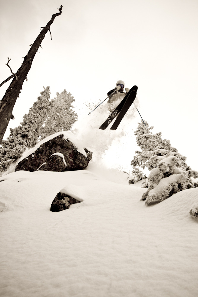 "With 22 inches in two days and a base approaching 70, there was ample snow for soft landings.  Skier Kevin ""Bert"" Flores launches one of innumerable rocks at Taos. Photo by Liam Doran"