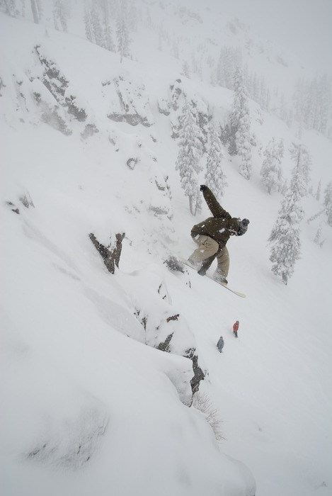 This snowboarder drops into some new powder at Sugar Bowl Ski Resort, California