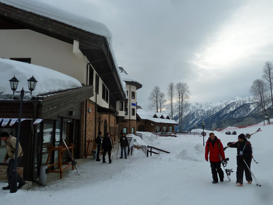 Skiers outside Rosa Khutor Mountain Lodge. - ©Brian Pinelli