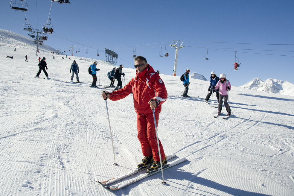 Ski instructor demonstrating turns in Claviere, Italy