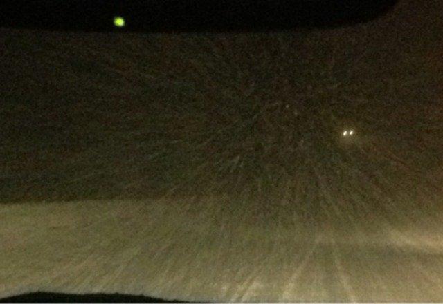 Snowing hard.