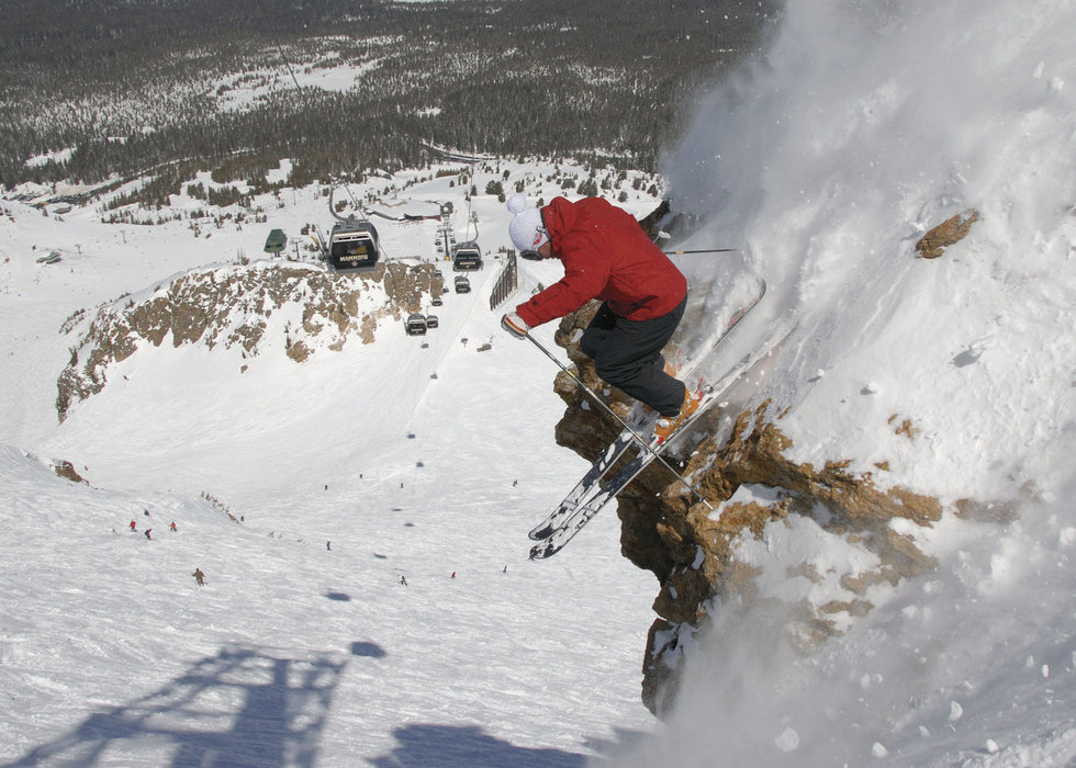 A skier goes off a cliff in Mammoth Mountain, California