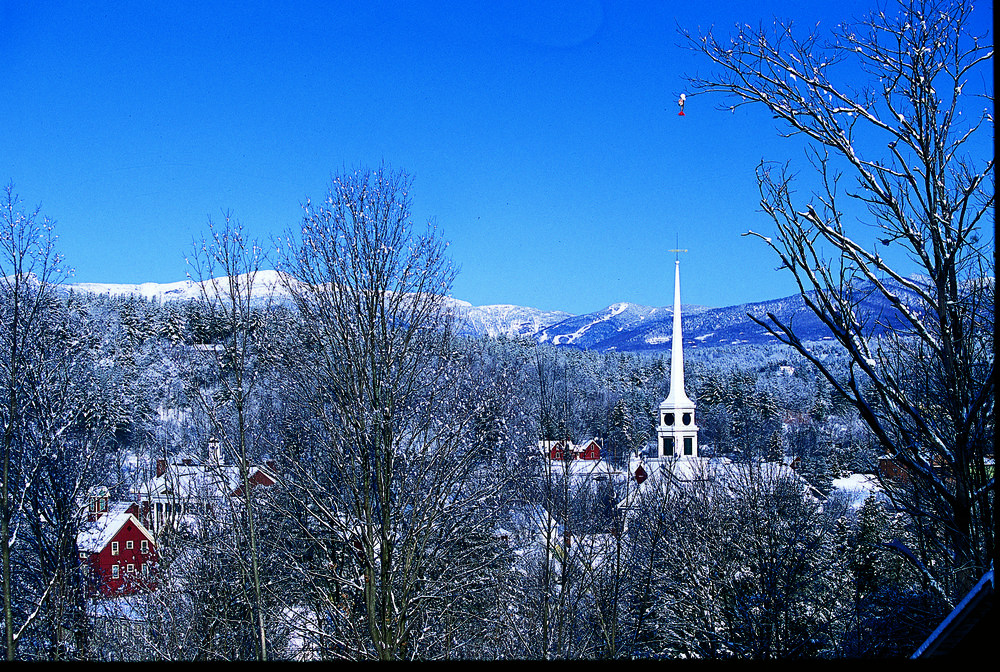 Stowe village with church steeple above treeline, Vermont