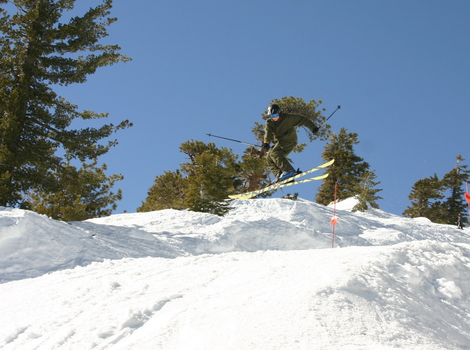 A skier performs a trick in the terrain park at Mt. Baldy Ski Resort, California
