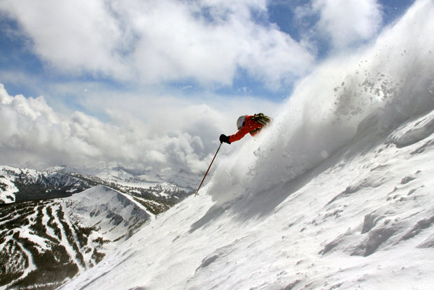 A skier descends the double black diamond Dictator Chutes at Big Sky.