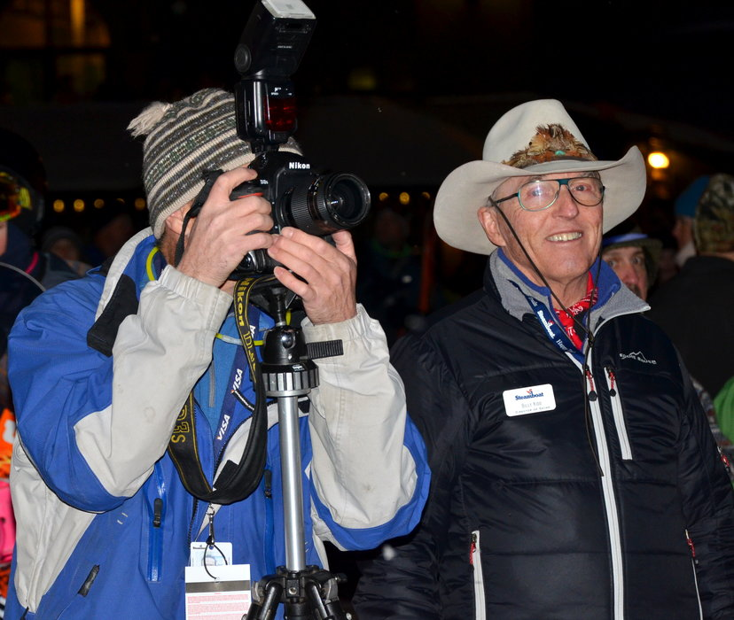 Olympian Billy Kidd watches the night skiing festivities with photographer John Russell.