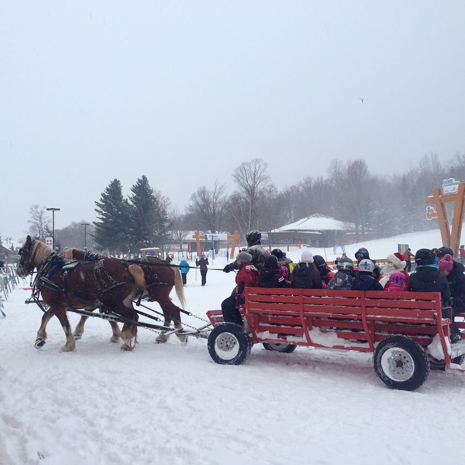 Santa pulling his sleigh at Mont-Sainte-Anne