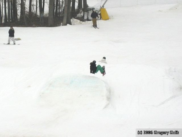 A snowboarder gets air off a jump in the terrain park at Cascade Mountain, Wisconsin