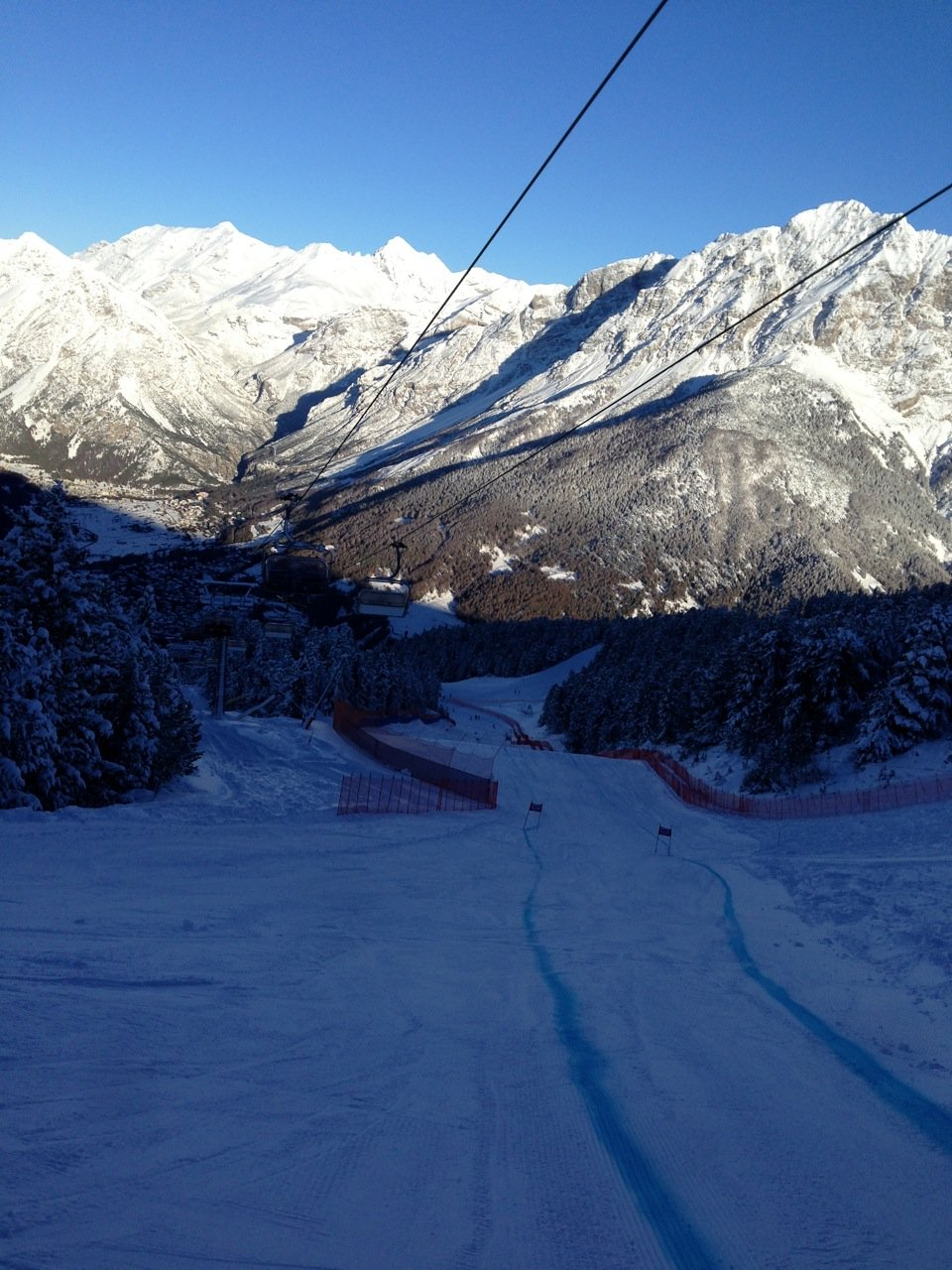Looking down a dark and bumpy Bormio.
