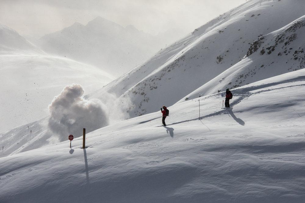 Ski patrollers doing control work at Lake Louise. - ©Liam Doran