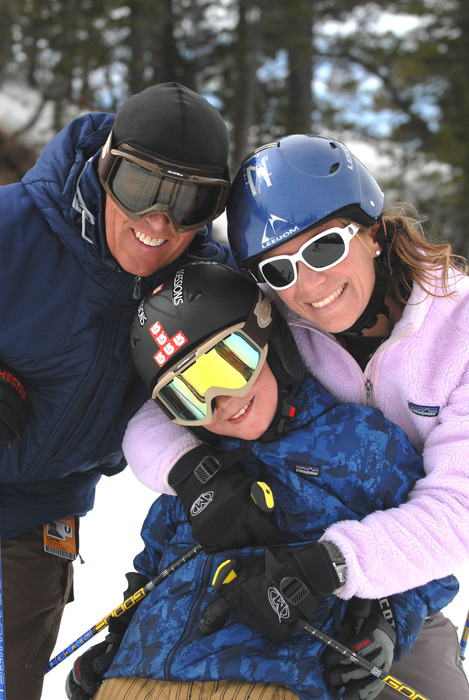 Family of skiers posing for picture
