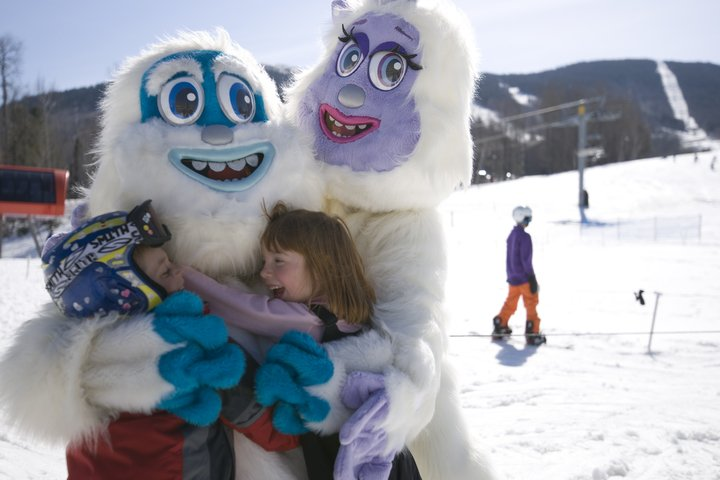 No Sunday River spring is complete without hugs from Eddy and Betty Yeti. - ©Sunday River