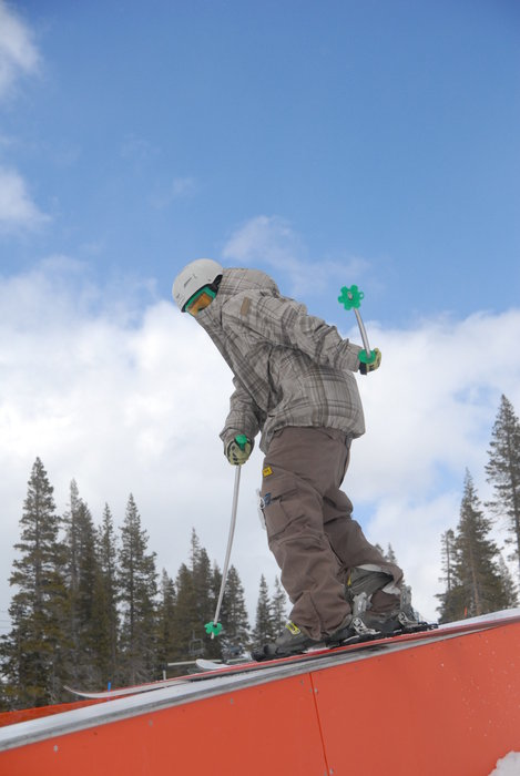 Freeskier on rails at terrain park