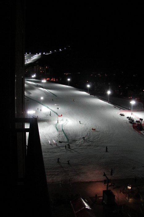 Cap off your day enjoying the new night skiing scene from the Sheraton's new Mountain Suites balcony. - ©Heather B. Fried