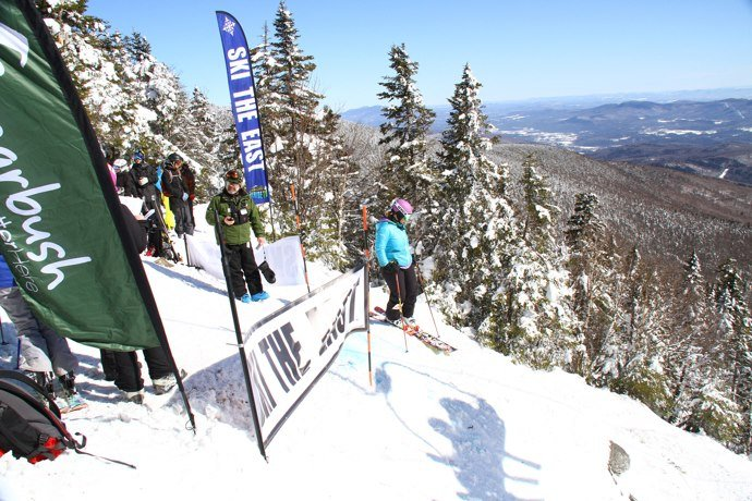 Skiers waits to drop in during the Castlerock Extreme at Sugarbush.