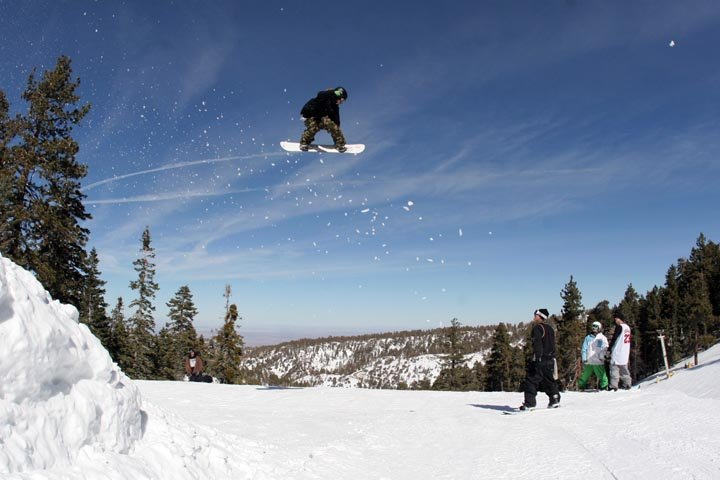 A snowboarder catching air at Mt. High, CA.
