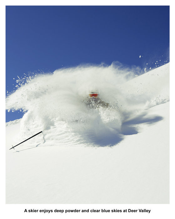 A skier enjoys deep powder and clear blue skies at Deer Valley. - ©Skiifo