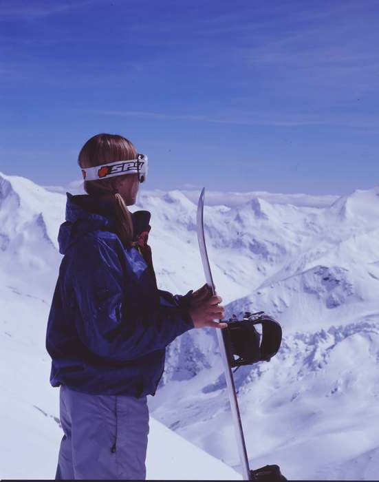 A snowboarder preparing to descend the slopes of Saas Fee.