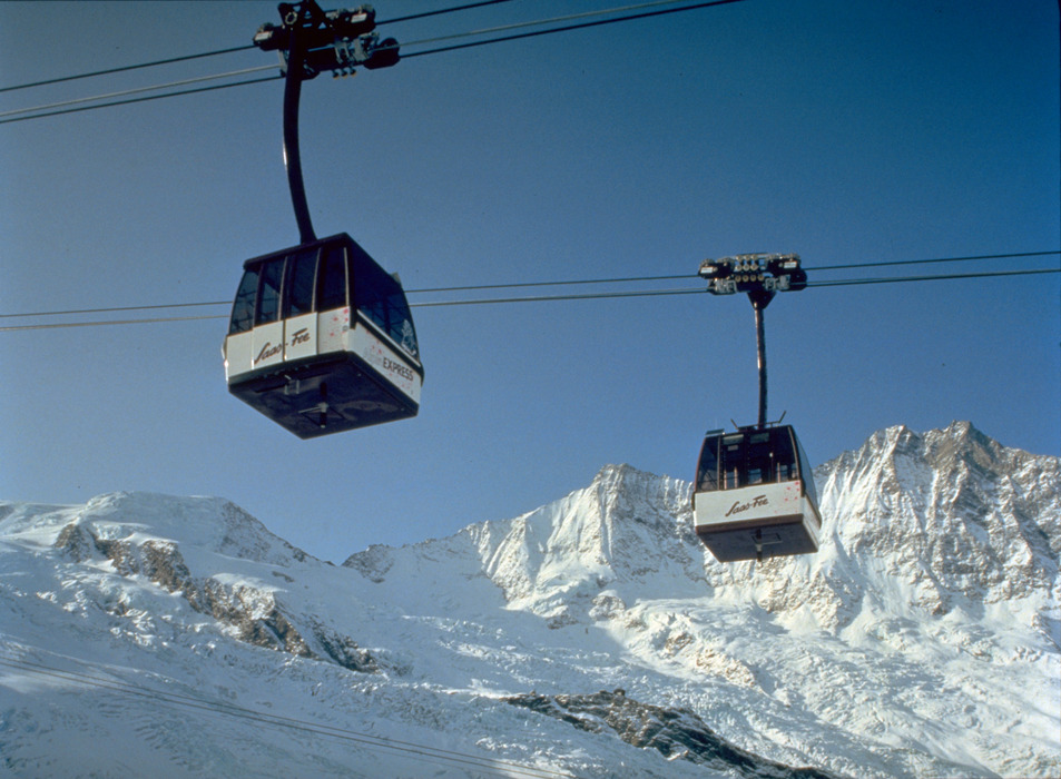 Gondolas of the Alpin Express gliding over Saas Fee.