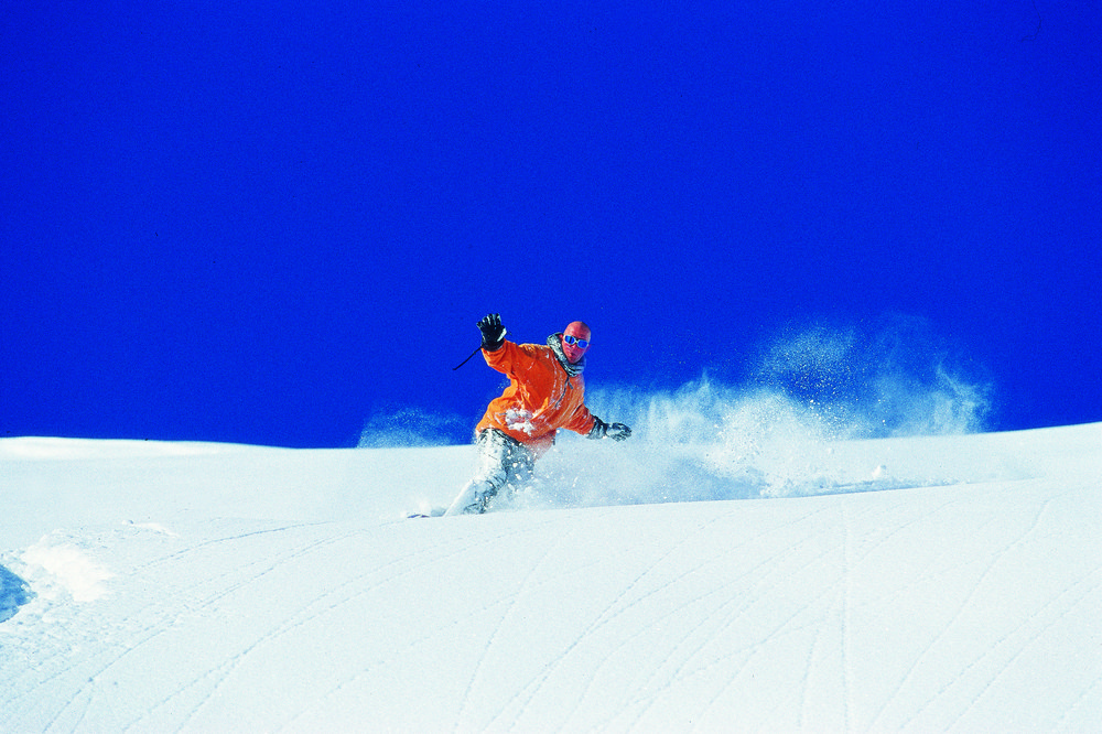 A snowboarder on the slopes of Hochfuegen AUT.