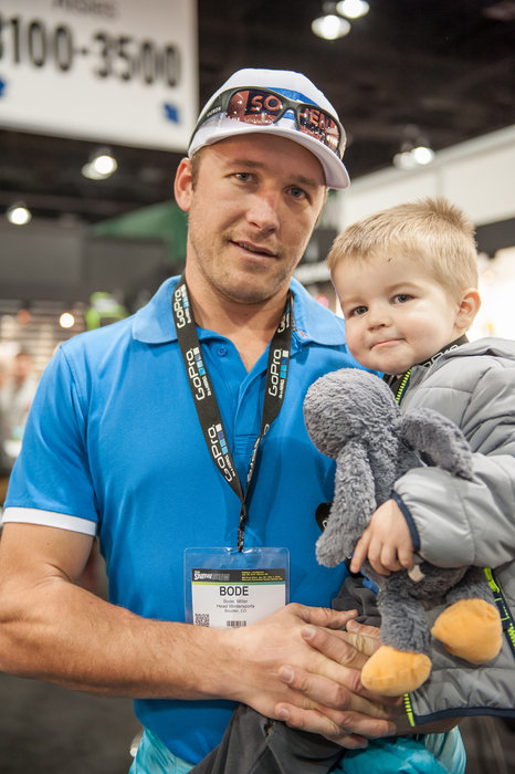 Bode Miller and son hanging out at the HEAD booth during SIA, just a week before what could be his last ski race. - ©Ashleigh Miller Photography