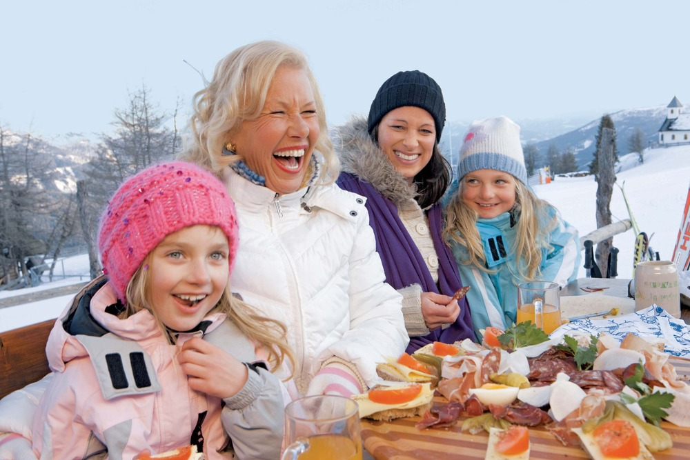 A family taking a break at a restaurant in Kaernten/Carinthia, AUT.