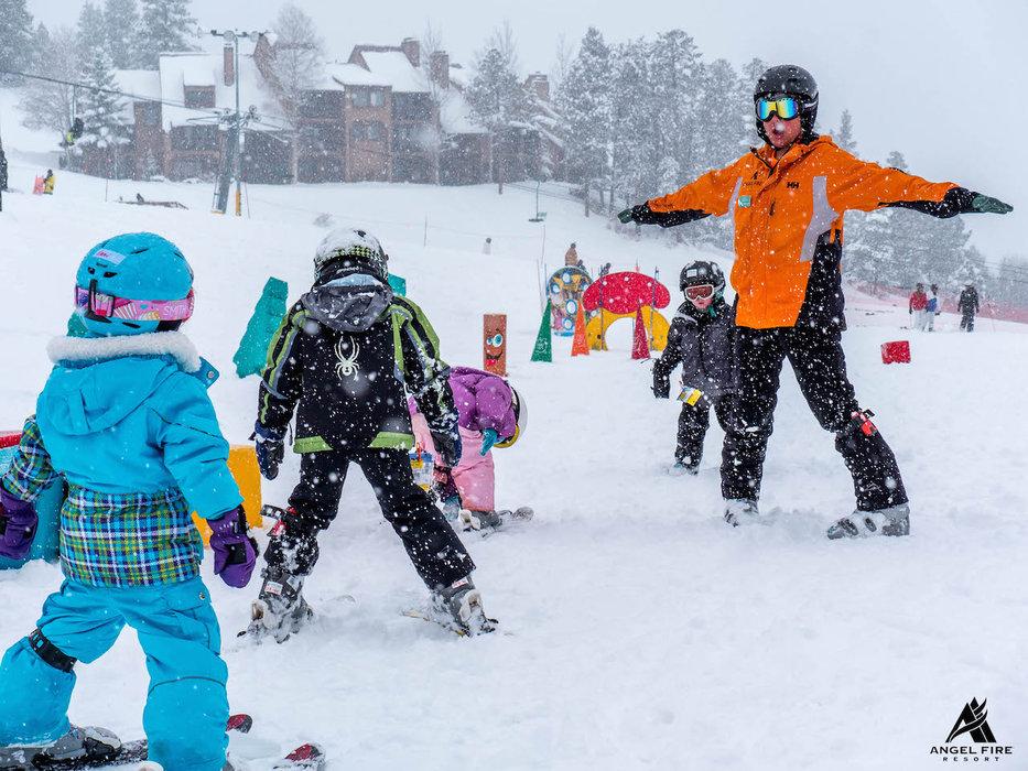 Kids enjoy new snow in late February 2015 at Angel Fire Resort. - ©Angel Fire Resort