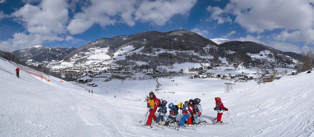 Kids following their ski school instructor in Bad Kleinkirchheim