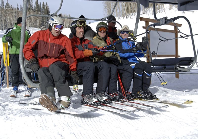 Three skiers and a snowboarder get in the chairlift in Steamboat, Colorado