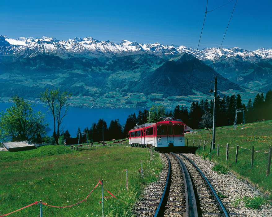 Switzerland. get natural. . Central Switzerland's Rigi mountain (1800 m) offers wonderful views over Lake Lucerne and the Alps. The Vitznau - Rigi Railway high above Rigi-Kaltbad. In the background, the Buochserhorn and the Central Switzerland Alps. . . Schweiz. ganz natuerlich. . Die Rigi (1800 m)