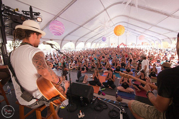 A yoga class set to the sounds of Michael Franti.