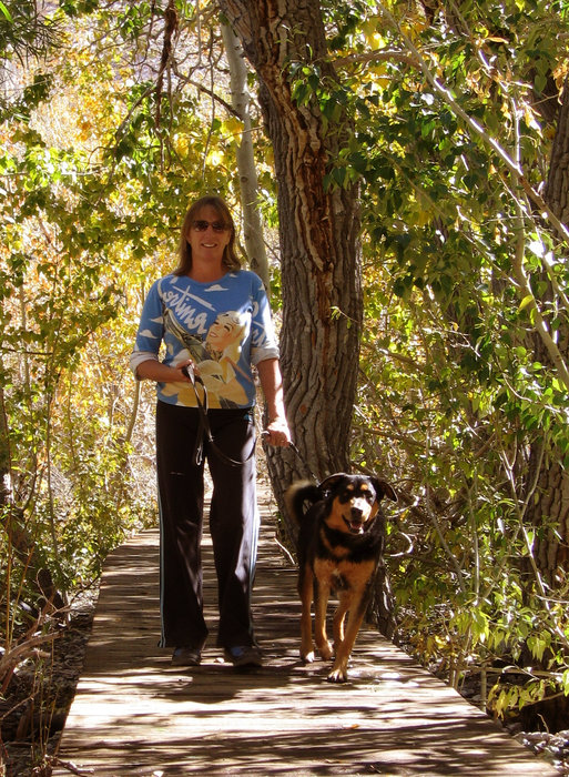 A woman walking a dog in Mammoth.