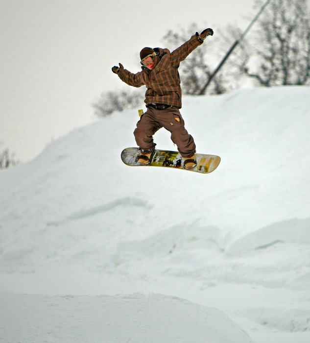 Snowboarder catching air at Wild Mountain, MN