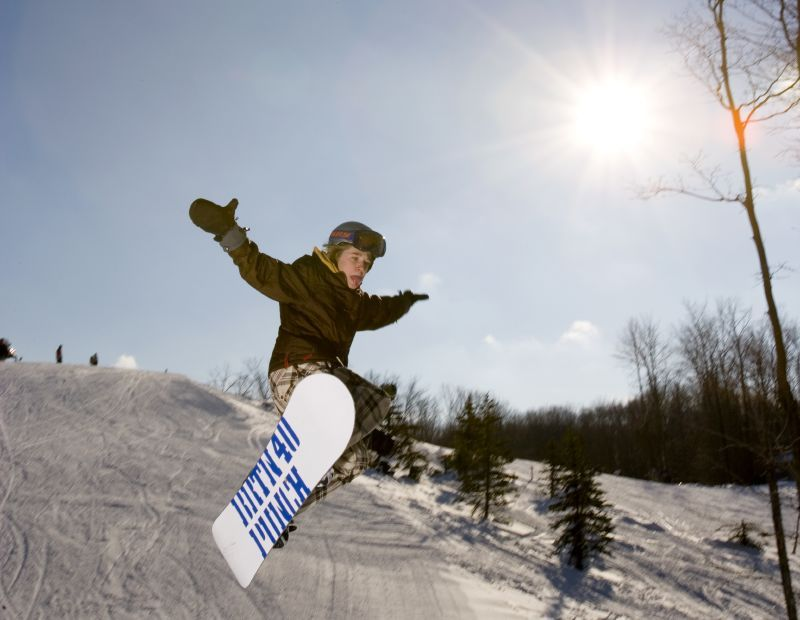 A snowboarder gets air in the terrain park, Shanty Park, Michigan