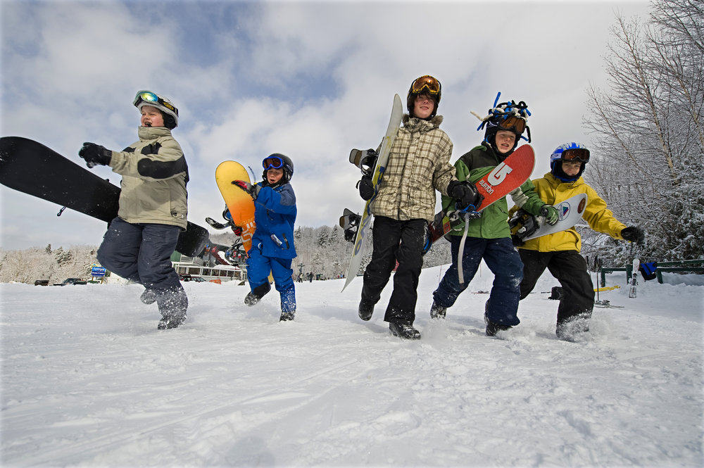 Kid snowboarders at Smugglers' Notch, Vermont.