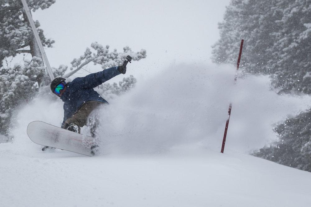 A snowboarder enjoys fresh powder on Peak 9 at the Breckenridge Ski Resort - ©Breckenridge Ski Resort