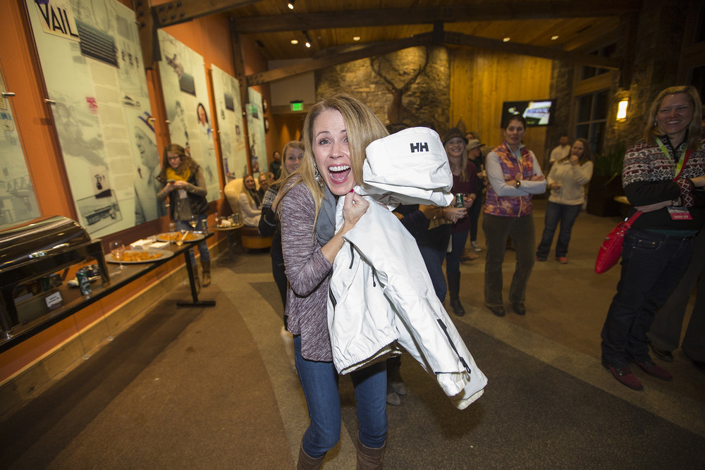 Trista Sutter scores the big ticket raffle item from night one: the Helly Hansen Diana Jacket. - ©Vail