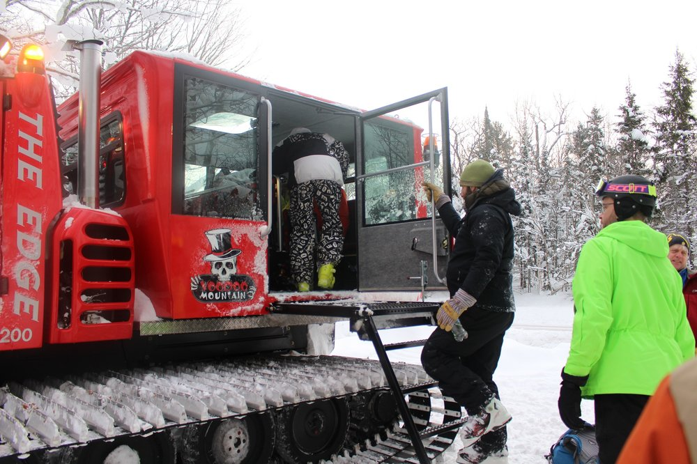 Skiers and riders load the snowcat on Voodoo Mountain. - ©Louise Kremer/Voodoo Mountain