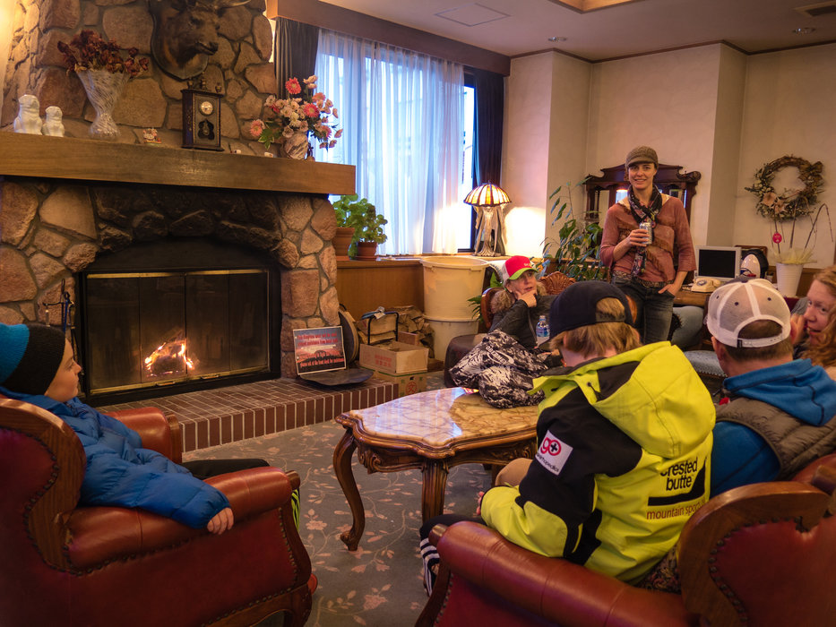 Skiers get cozy by the fire in the Niseko Park Hotel, within walking distance of the slopes. - ©Linda Guerrette