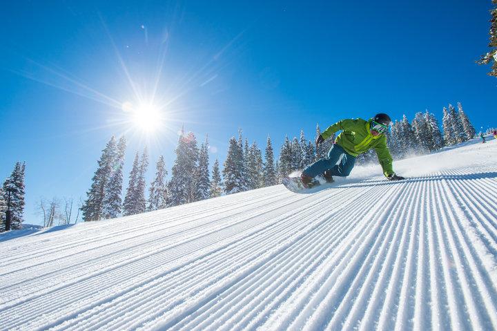 A snowboarder enjoys a groomer at Aspen Highlands. - ©Scott Markewitz Photography, Inc.