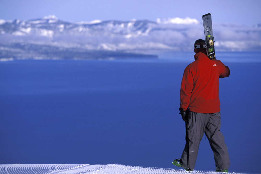 Skier taking in the view of Lake Tahoe at Heavenly CA