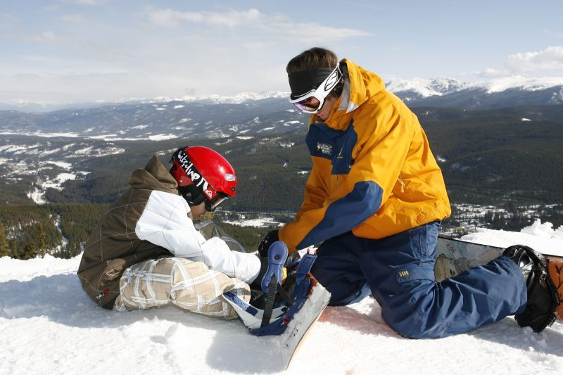 A kid learns to snowboard in Winter Park, Colorado