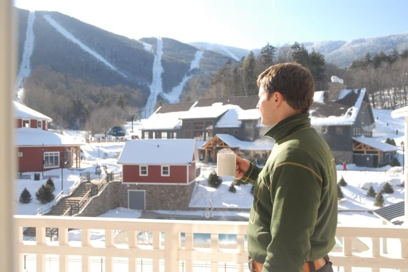 A man gets a view of the village at Sugarbush Resort, Vermont