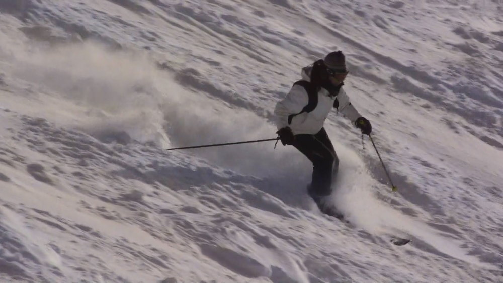 Skier in fresh powder at Cairngorm, Scotland