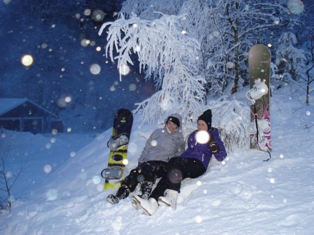 Boarders taking a break under snowy conditions at Winterberg, Germany.