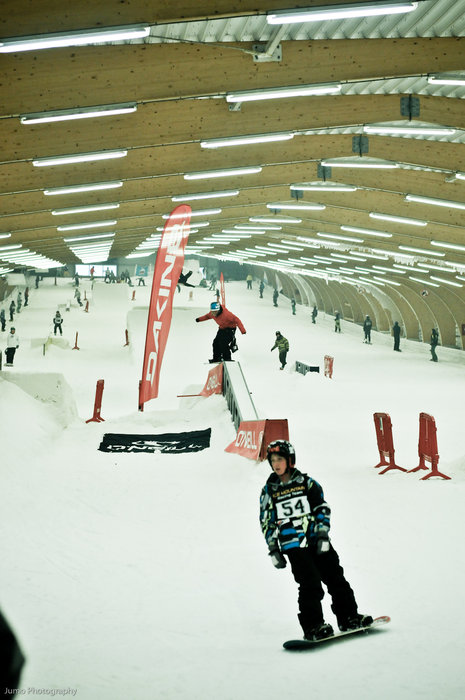 Snowboarders on the Ice Mountain, Belgium terrain park for an event.